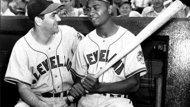 Manager Lou Boudreau and Larry Doby stand in the dugout at Comiskey Park in Chicago on July 5, 1947, the day Doby became the first black player in the American League.