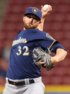 The Brewers designated reliever David Goforth for assignment and claimed right-hander Blake Parker from the Los Angeles Angels.