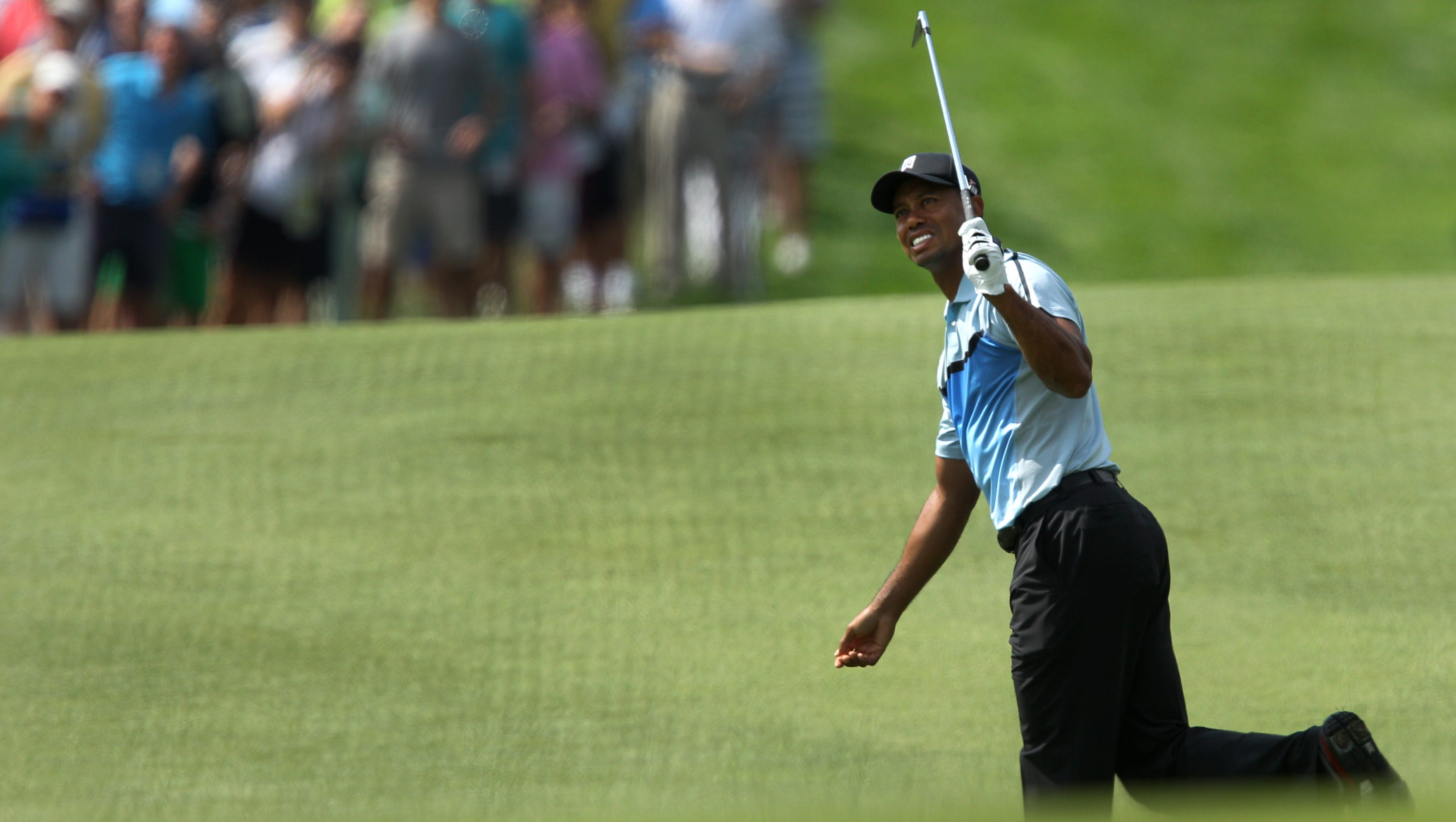 Tiger Woods reacts to his shot on 18.