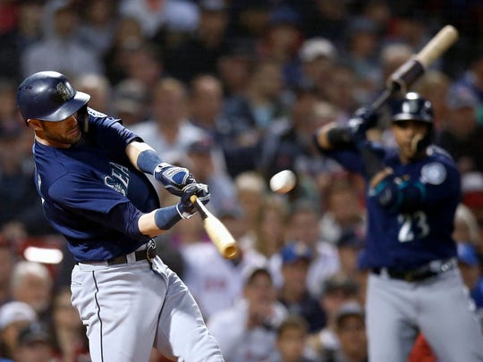 Seattle Mariners' Mitch Haniger hits a two-run double during the fourth inning of a baseball game against the Boston Red Sox in Boston, Saturday, June 23, 2018. (AP Photo/Michael Dwyer)