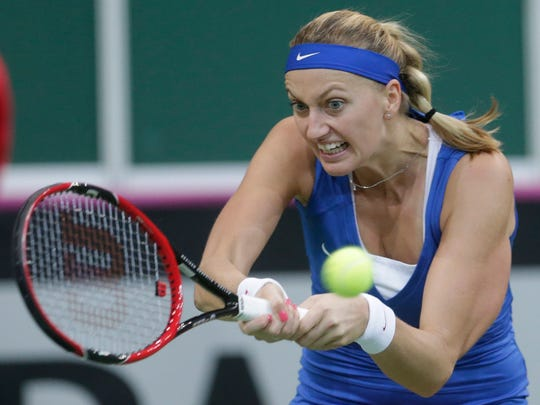 Czech Republic's Petra Kvitova returns a ball to Russia's Anastasia Pavlyuchenkova during their Fed Cup tennis final match between Czech Republic and Russia in Prague, Czech Republic, Saturday, Nov. 14, 2015.