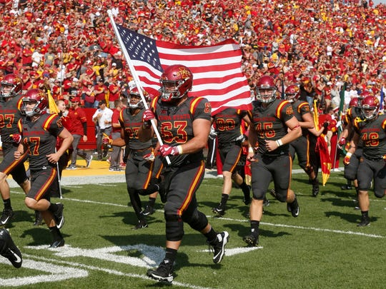 Iowa State senior Robby Garcia carries the United States