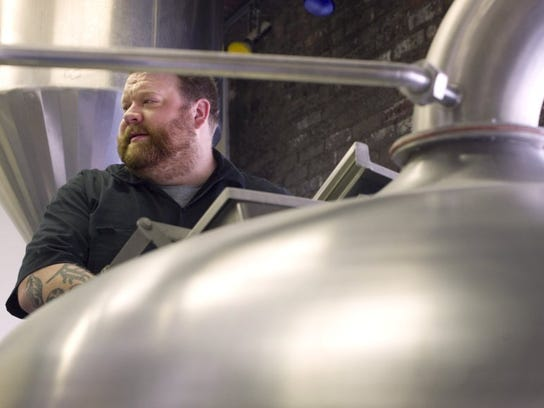 DENNY SIMMONS / COURIER & PRESS Turoni's-then head brewer Josh Pietrowski begins cleaning the brewery's equipment before starting another batch of beer back in 2016.