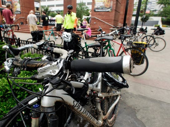 Bicycles sit parked as riders enjoy coffee and baked good on Market Square during Bike to Work Day on June 3, 2016, in Knoxville.