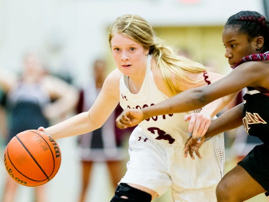 Alcoa's Riley Hicks (3) dribbles down the court during