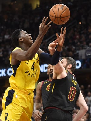 Apr 29, 2018; Cleveland, OH, USA; Indiana Pacers guard Victor Oladipo (4) drives to the basket against Cleveland Cavaliers center Kevin Love (0) during the first half in game seven of the first round of the 2018 NBA Playoffs at Quicken Loans Arena. Mandatory Credit: Ken Blaze-USA TODAY Sports
