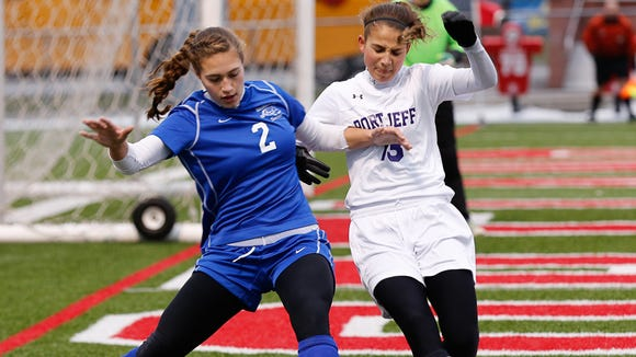Bronxville's Caitlin Fryer, left, battles Port Jefferson's Corinne Scannell in the Class B Championship at SUNY Cortland on Sunday.