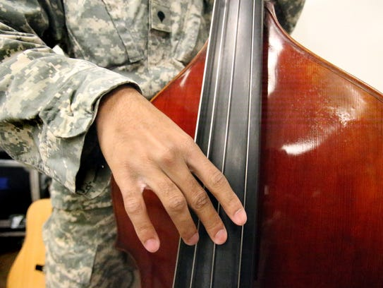 An upright bass is among the instruments played in