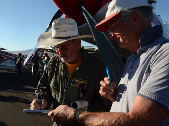 Dennis Sanders signs an autograph after placing third on Sunday in the Breitling Unlimited Gold at the Reno National Championship Air Races.