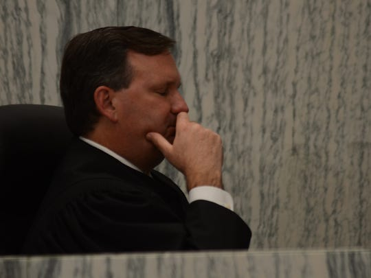Washoe County District Judge Elliot Sattler closes his eyes momentarily as he watches a video of Jason Brown, 25, of Reno, kill two dogs at a local hotel room last year.