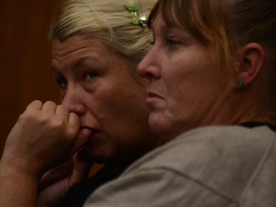 Two onlookers hold back tears at a sentencing hearing for Reno resident Jason Brown on Oct. 1, 2015 in the Washoe District Court.