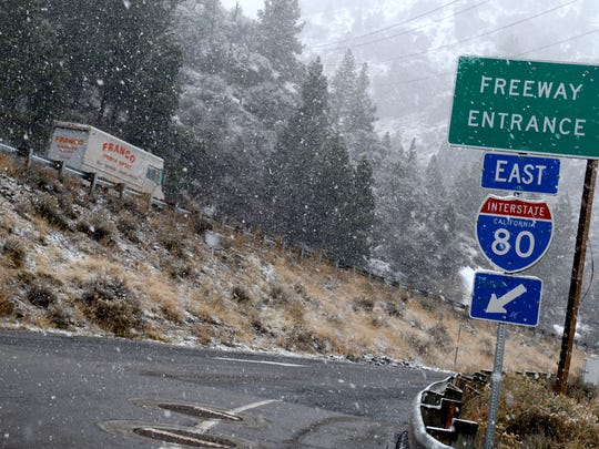 A file photo showing snow falling along eastbound Interstate 80 just outside Truckee.
