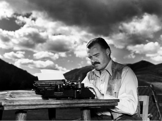 ITH Hemingway at a typewriter