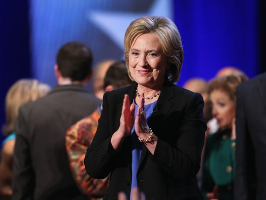 Hillary Clinton greets guests following the Democratic