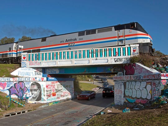 An Amtrak train crosses over the Graffiti Bridge after making a stop in Pensacola in February 2016 as part of the Southern Rail Commission's Gulf Coast Passenger Rail inspection trip.