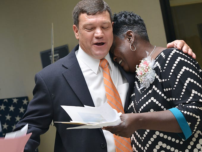 Joann Gibbs is overcome with emotion after Tax Assessor