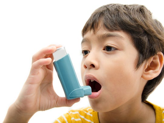 A child uses an inhaler, in this undated file photo.