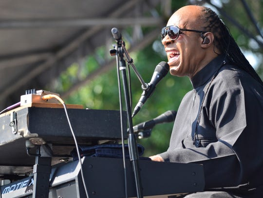 Stevie Wonder performs during an exclusive press conference