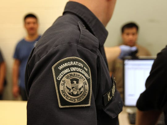 Undocumented Mexican immigrants are photographed while
