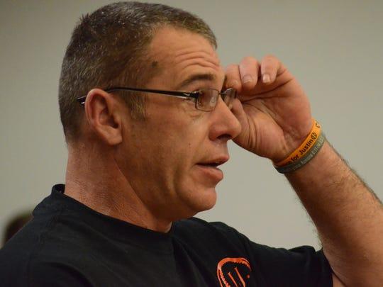 Jeff Madden, wearing a bracelet honoring his son, speaks