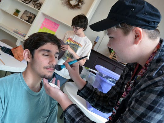 Roni Prisock, 14, of Madison, applies makeup to Joseph Welch 16, of Winona, as they prepare for dress rehearsals during the 14th annual Canton Young Filmmakers Workshop held in Canton.
