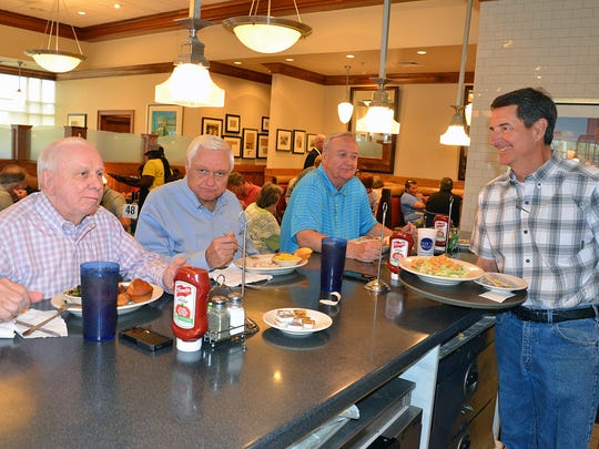 Don Primos, right, serves regular customers, from left, John Wallace of Byram, Emmett Haddox of Jackson and Doug Downing of Flowood during lunch hour at the Flowood Primos location.