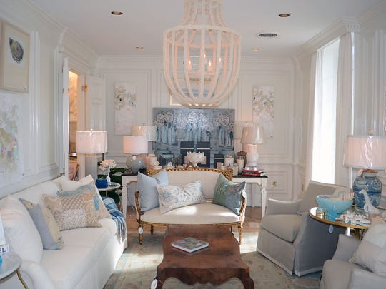 Furniture is arranged as if one is walking through room in a home at Courtney Peters Interior Design.
