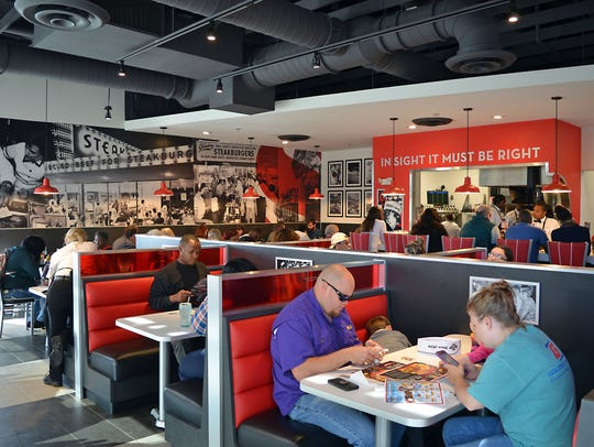 Steak 'n Shake customers enjoy their meal and the restaurant