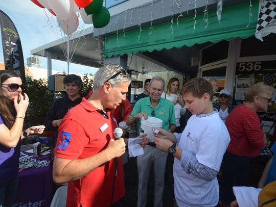 Jim Buonavolonta, left, helps kids match up with a