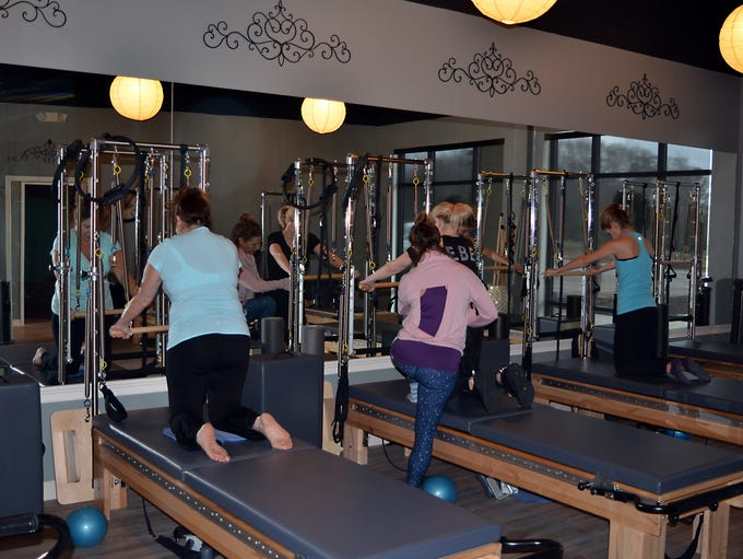 Members work out at Connections Pilates located at