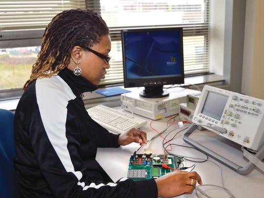 Serita-Campell-works-on-a-circuit-board..jpg