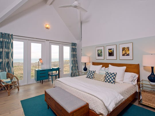The third floor master suite takes in ocean and dune