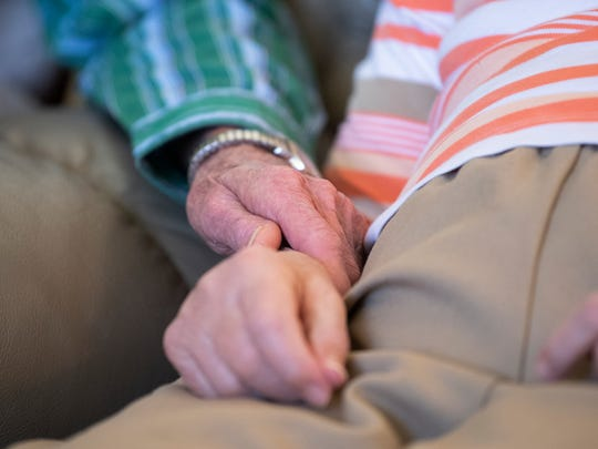 "Harold Johnson holds the hand of his wife, Sandra Johnson, on Friday, Feb. 9, 2018, while they watch television at Regency Retirement Village in Jackson. ""She's always liked holding hands,"" Harold said. ""Or maybe it's just me who likes it."""