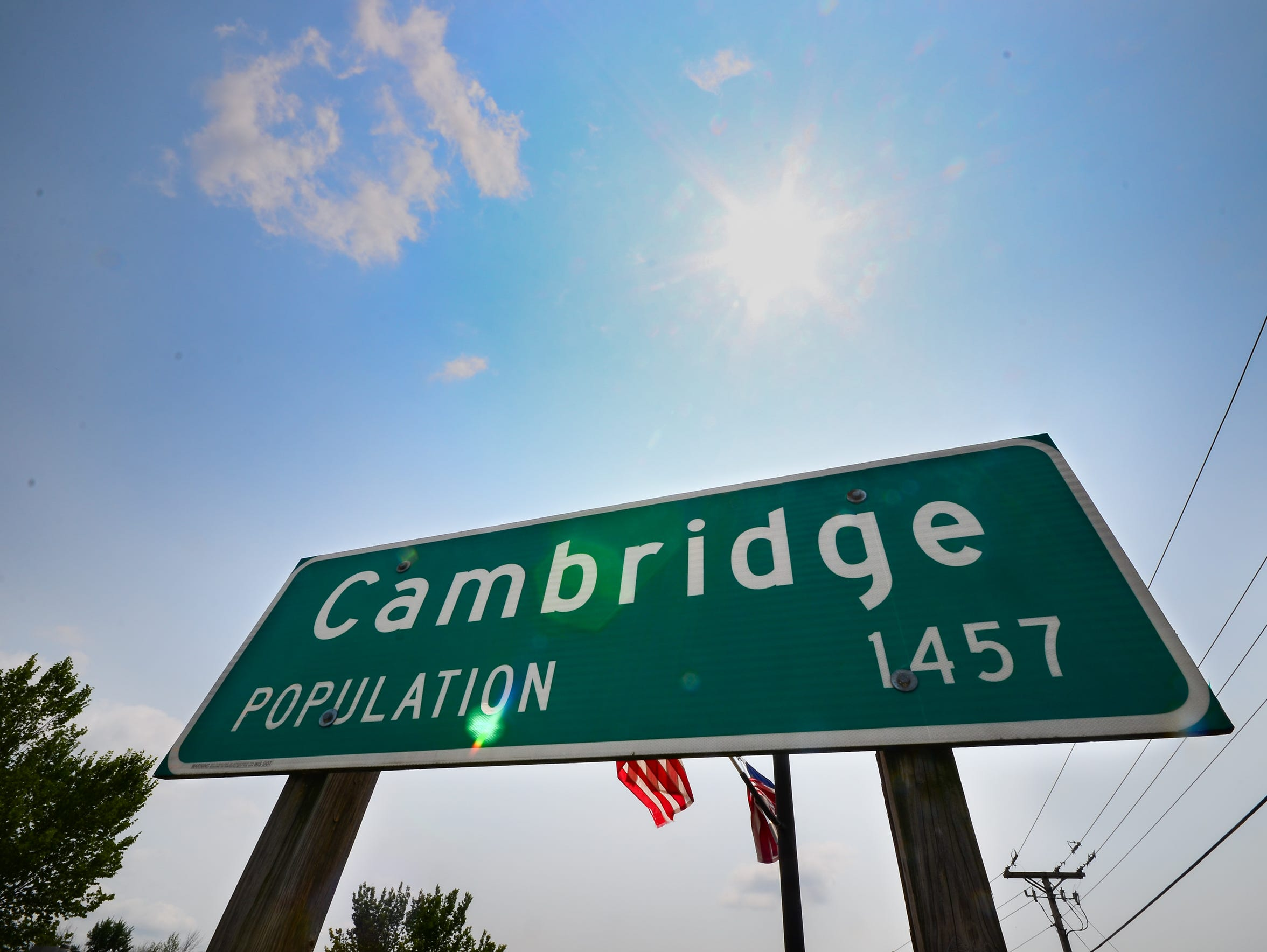 A sign at the edge of town shows Cambridge's population of 1,457 from the 2010 census.