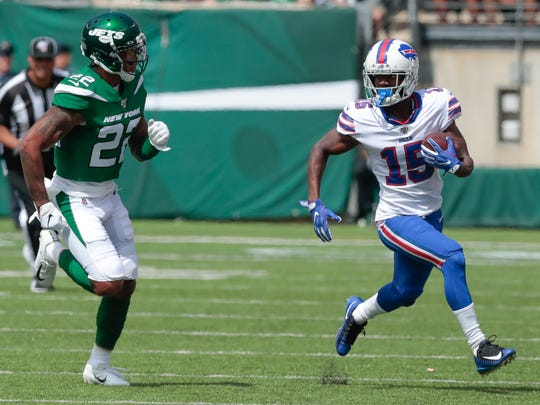 Sep 8, 2019; East Rutherford, NJ, USA; Buffalo Bills wide receiver John Brown (15) gains yards after catch as New York Jets cornerback Trumaine Johnson (22) pursues during the first half at MetLife Stadium. Mandatory Credit: Vincent Carchietta-USA TODAY Sports