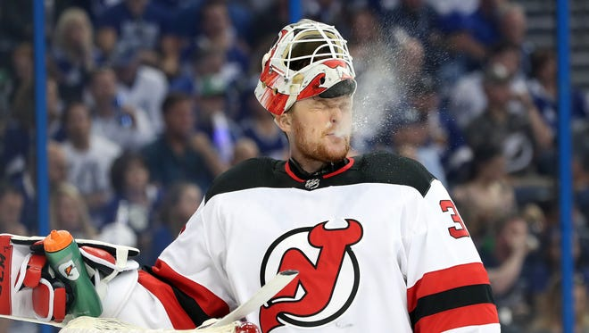 Apr 21, 2018; Tampa, FL, USA; New Jersey Devils goaltender Cory Schneider (35) sprays water from his mouth against the Tampa Bay Lightning during the first period of game five of the first round of the 2018 Stanley Cup Playoffs at Amalie Arena.