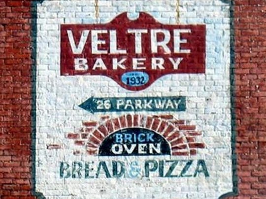 A classic sign on the wall outside of Veltre's Bakery.