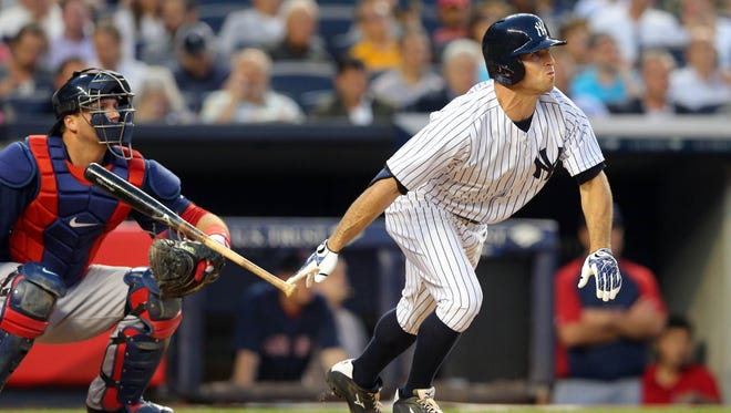 New York Yankees left fielder Brett Gardner (11) hits a solo home run against the Boston Red Sox during the fourth inning of a game at Yankee Stadium.