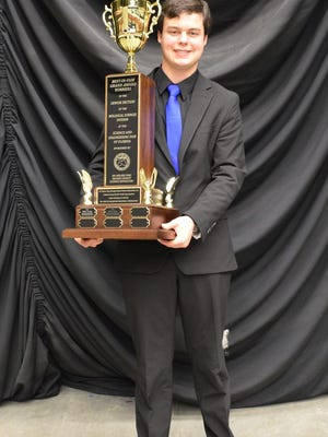 River Grace of West Shore Jr./Sr. High School holds the Nelson Ying Scholar trophy he earned after winning Senior Best of Show honors at the Florida State Science and Engineering Fair held in Lakeland from March 31-April 2
