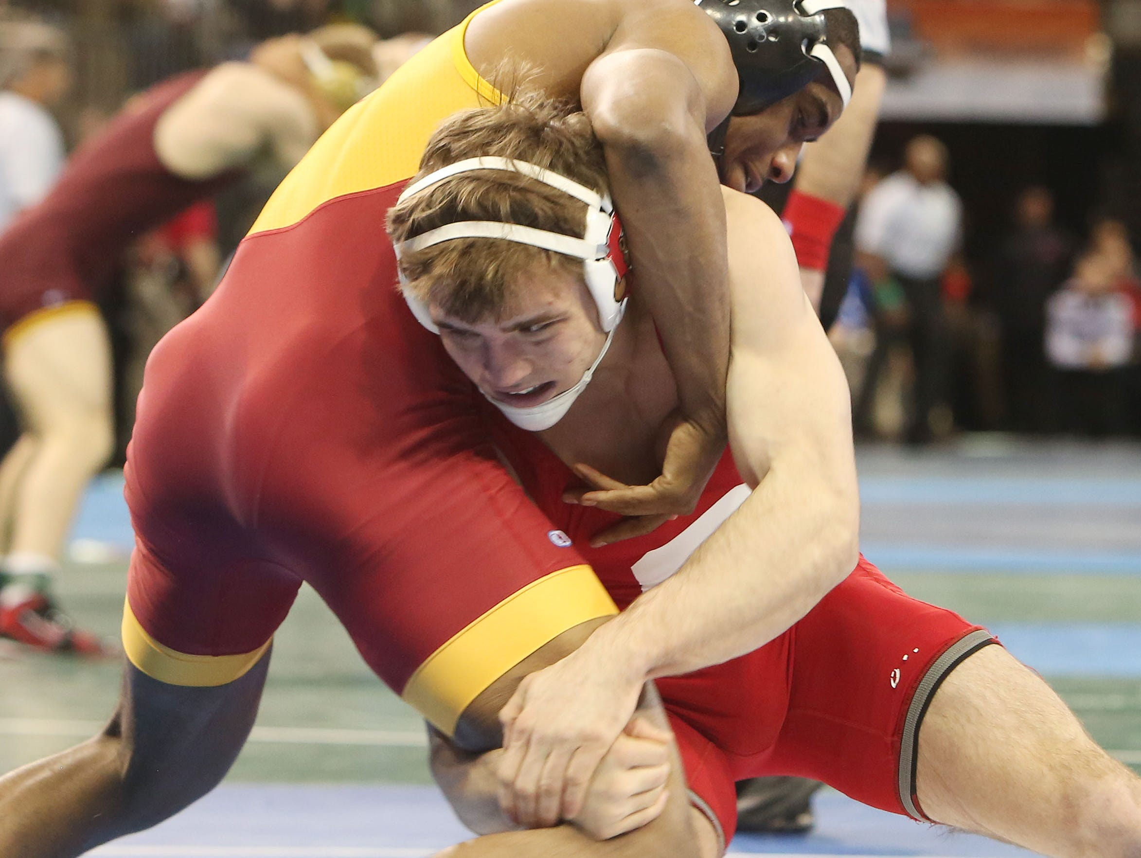 From right, Cornell's Brian Realbuto wrestles against Iowa State's Leland Weatherspoon in the quarterfinals in the 174-pound weight class during the NCAA Wrestling Championships at Madison Square Garden March 17, 2016. Weatherspoon won the match knocking off the number two seed Realbuto.