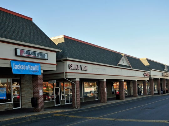 Southgate Shopping Center, Chambersburg, photographed Nov. 25, 2015, has a lot of building code violations. The problems include roof damage and mold in several buildings.