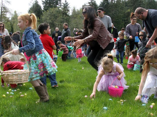 Easter egg hunters spread out to collect the goodies Sunday at Sedgwick Junior High.