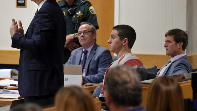 Austin Harrouff (center right) appeared in court Wednesday, Feb. 22, 2017, during a defense motion hearing at the Martin County Courthouse in downtown Stuart. The hearing concerned the potential release of an unbroadcast interview Harrouff made with the Dr. Phil show in 2016. To see more photos, go to TCPalm.com.