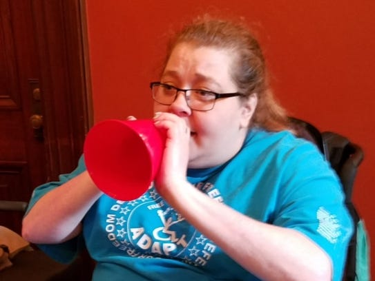 Michelle Fridley of Canandaigua participates in a protest