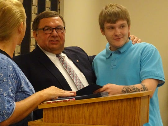 """Municipal Judge Frank Ardis Jr. said graduate Trustin Hale was reluctant to start the program, but was an example of why parents need to be involved to support their children through treatment. Hale's mother, Jan, said drug court finally opened her newly 20-year-old son's eyes to the """"evil"""" of alcohol."""