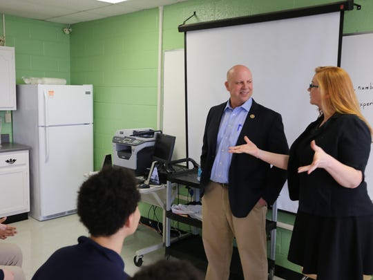 U.S. Rep. Scott DesJarlais listens to Daniel McKee Alternative School teacher Mariah Phillips as she speaks about the Capitol Hill Challenge February 2016 in her classroom.