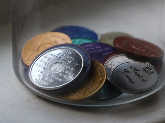 Danielle Ayers was sober for 18 months and still keeps coins that marked her amount of clean time.