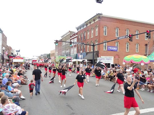 Majorettes from the Bucyrus High School marching band perform before a packed crowd Thursday during the parade at the Bucyrus Bratwurst Festival.