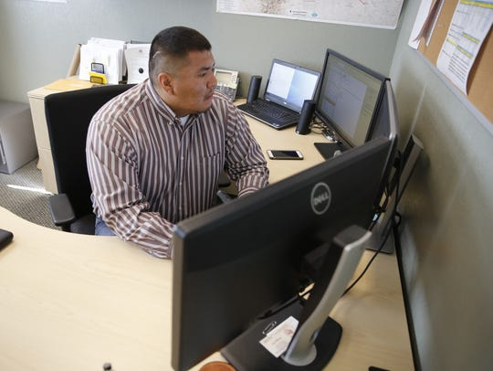 Troy Watson, pipeline engineer, answers a phone call