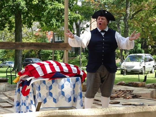 "Vane Scott presents a flag demonstration, ""The Many faces of Old Glory,"" during Living History Days."